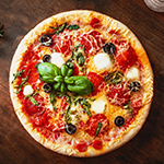 Hot pizza with Pepperoni  with vegetables and fresh ingredients on rustic wooden table. Pizza menu. View from above.