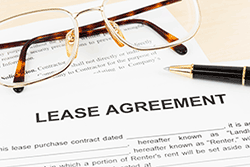 Lease Agreement with Glasses and Pen